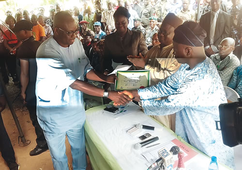 GOVERNOR-ELECT AYO FAYOSE RECEIVING HIS CERTIFICATE OF RETURN