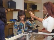 Waje and winner browse through the store