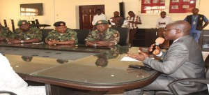 Ekiti State D. Gov., Dr. Kolapo Olusola (right)addressing Major Gen. Sannusi Nasir Muazu, GOC 2 Division, Nigeria Army and others with him during the GOC's  visit to the state.