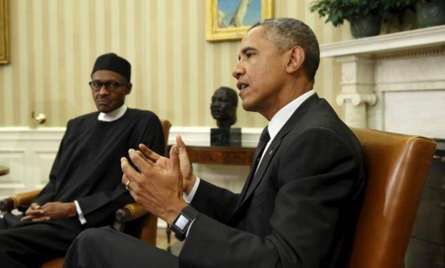U.S. President Barack Obama meets with Nigerian President Muhammadu Buhari (L) in the Oval Office of the White House in Washington July 20, 2015. REUTERS/Kevin Lamarque