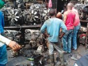 Spare parts dealers repairing engine blocks at Ladipo