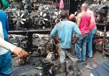 Spare-parts-dealers-repairing-engine-blocks-at-Ladipo-