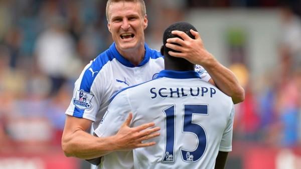 Robert Huth Celebrates Leicester's Perfect Premier League Start With Jeffrey Schlupp. Image: Getty via Premier League.