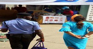 policeman carrying bag