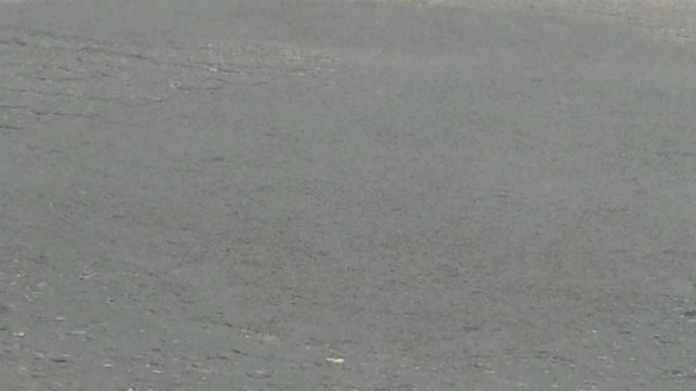 Quikfix Road Repair-Ghana 2 months later-No depressions cracking  wear or tear-Copyright QHL 2015