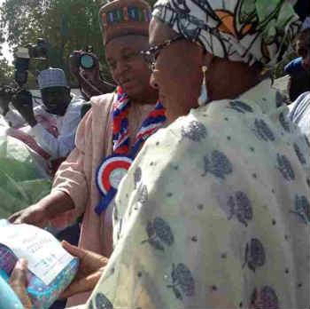 Aisha Buhari with WBFA Goodybag Donated by Toyin Saraki Towards Helping IDPs in Borno State
