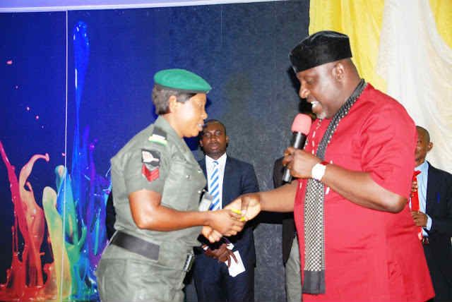 Governor Okorocha handing over the keys of the brand new car to  Mrs. Blessing Ogbuefi at the Nicks Banquet Hall, Government House, Owerri on 15th December 2015