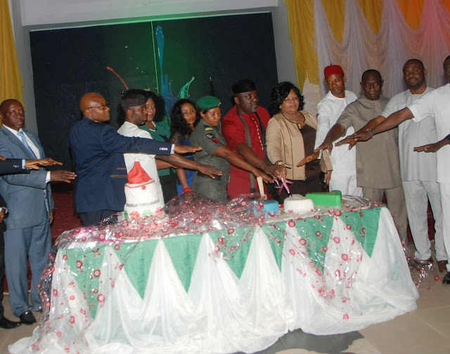 Governor Okorocha, his wife and others cutting the cake during the end of year party