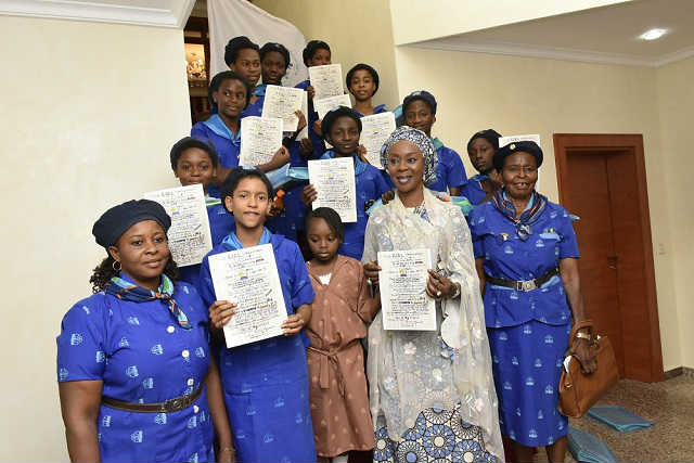 Her Excellency Mrs Toyin Saraki with Members of the Holy Rosary Girls College Girl Guides Area Council Gwagwalada Holding the Girl Declaration