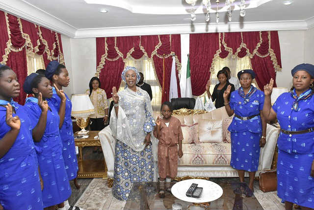 Her Excellency Mrs Toyin Saraki with Members of the Holy Rosary Girls College Girl Guides Area Council Gwagwalada Reciting the Girl Guides' Promise