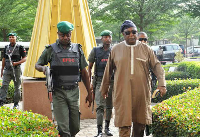 Alex S. Badeh with EFCC official