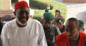 Olisa Metuh in court with EFCC official