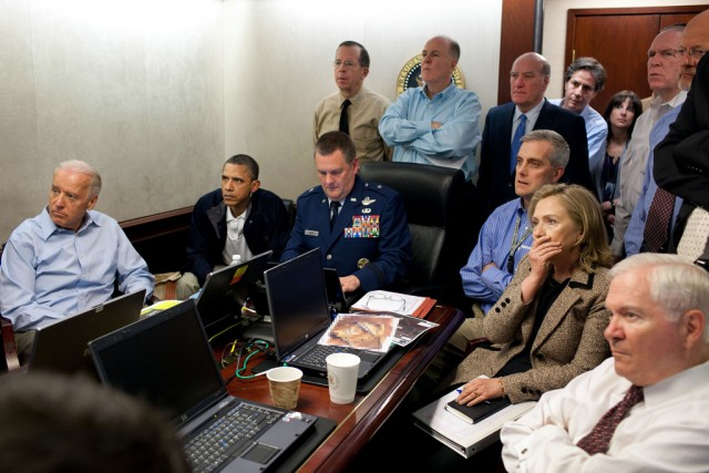 President Barack Obama and Vice President Joe Biden, along with members of the national security team, receive an update on the mission against Osama bin Laden in the Situation Room of the White House, May 1, 2011. Please note: a classified document seen in this photograph has been obscured. (Credit: Official White House photo by Pete Souza)