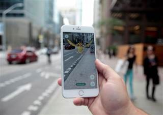 "A ""Pidgey"" Pokemon is seen on the screen of the Pokemon Go mobile app, Nintendo's new scavenger hunt game which utilizes geo-positioning, in a photo illustration taken in downtown Toronto, Ontario, Canada July 11, 2016."