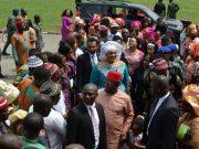 Ebonyi State Governor David Umahi in eye glasses and his wife Rachel Umahi wearing while head gear