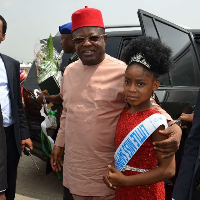 Ebonyi State Governor David Umahi with Little Miss Saphina who welcomed him to the National Stadium in Surulere, Lagos  venue of the 2016 Ebonyi Culural Day celebration on Friday, 18th November, 2016
