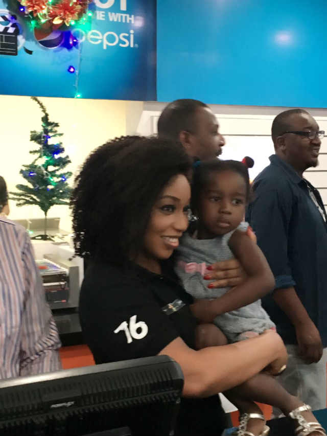 Rita Dominic with a baby