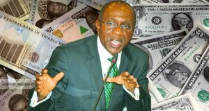 CBN Governor with Naira Dollar