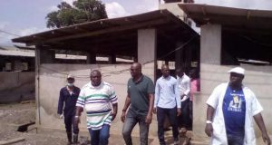 Hon Adebutu and Governor Fayose coming out of one of the pen blocks at Solomon Kesington Agro Allied Limited Iperu Remo  WA