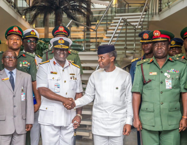 Acting President Yemi Osinbajo with some Officers during National Defence College Strategic Report Presentation