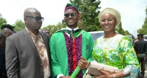 Governor Ayodele Fayose and his wife Mrs Feyisetan Fayose with their son Rogba during his Convocation Ceremony at Covenant University Ota Ogun State on Friday