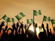 Nigeria and Nigerians People Waving Nigerian Flags
