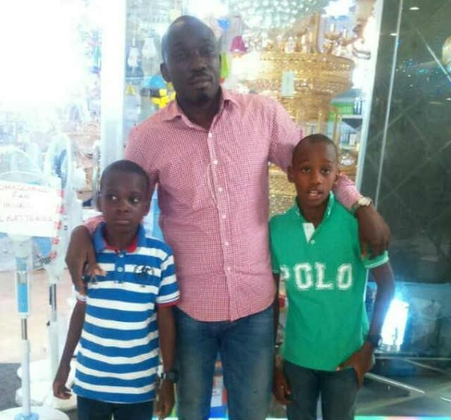 Moyosore and Morolayo Bakre and their father Ayo Bakre