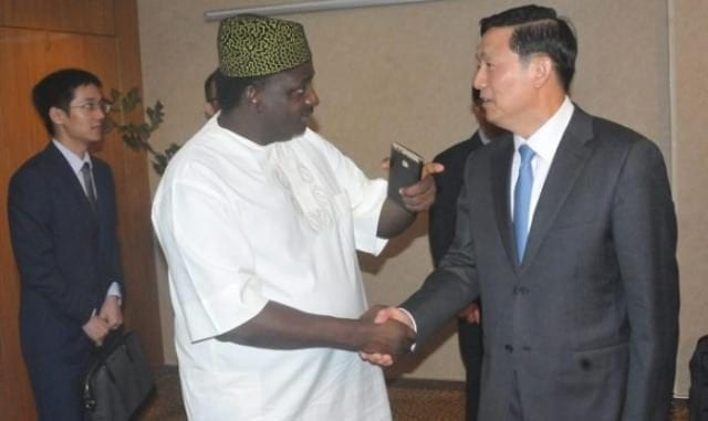 Mr Femi Adesina with Vice Minister of Information of State Council, People's Republic of China, Mr Guo Weimin