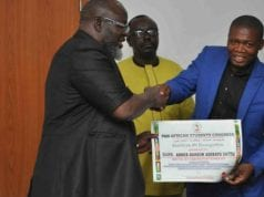 Nigeria's Minister of Communications receiving an Award from Pan-African Congress' International President Monami Coulibally Ahmed of Cote d'Ivoire