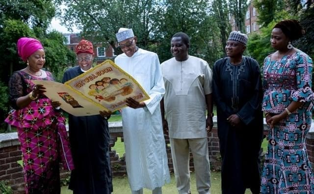 President Muhammadu Buhari being presented with Get-Well-Soon card in London by Alhaji Lai Mohammed and others