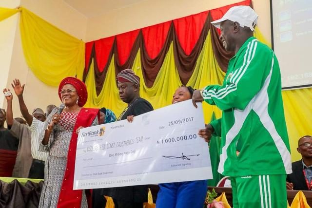Presentation of N1m Cheque to the winners of the State of Osun Calisthenics Competitions which held in the 9 Federal Constituencies in the state.