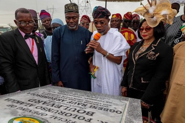 L-R: Governor, State of Osun, Ogbeni Rauf Aregbesola (Second Right); Chancellor, UNIOSUN, Chief Mrs Folorunso Alakija (right); Pro-Chancellor UNIOSUN, Mallam Yusuf Alli (second left); and Vice Chancellor, UNIOSUN, Prof. Labo Popoola at the formal opening of the access road to the University of Osun (UNIOSUN) on Thursday 19th October, 2017.