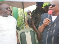 Abia State Governor, Dr Okezie Ikpeazu (in white) and Rivers State Governor, Barrister Nyesom Ezenwo Wike (in navy blue)