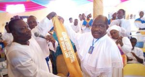 Special Evangelist Gbenga Sopelola receives the insignia of title from Prophet Alomanoaboe