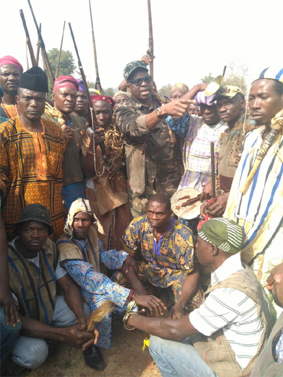Ekiti Stat Governor Ayodele Fayose with some Hunters in the state