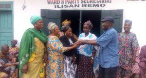 Hon Seye Sonuga hands over Alhaja Funmi Muhammed (middle) to ward 8 executives