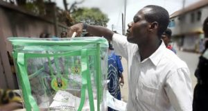 A Nigerian Voter casting his vote during an election