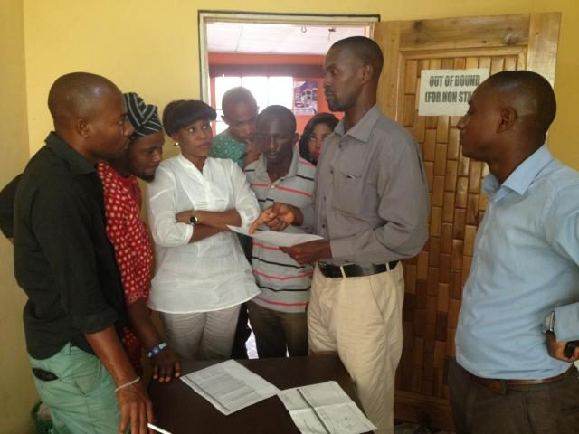 Oradian's Head of Implementation Onyeka Adibeli working with the staff of a Nigerian microfinance institution (MFI) to digitise and eliminate manual pen-and-paper processes