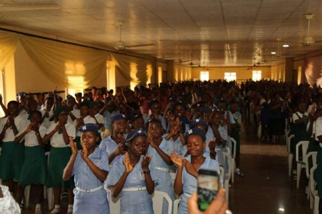 Student participants give Yeye Adenike Adebutu standing ovation after her speech