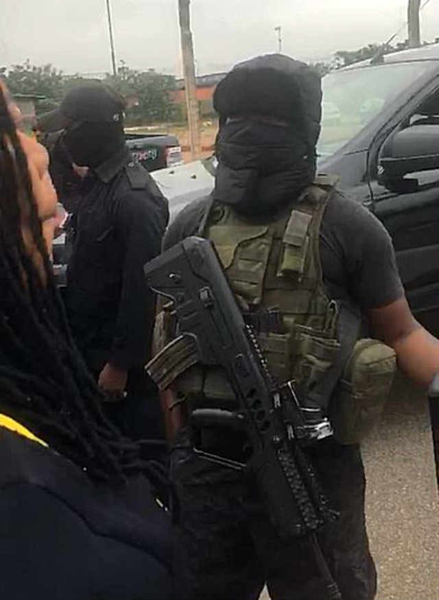 Masked security personnel at the NASS Complex, Abuja