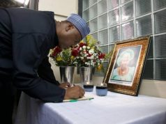 Senate President Bukola Saraki signing the Condolence Register for Ma Goldcoast Dickson