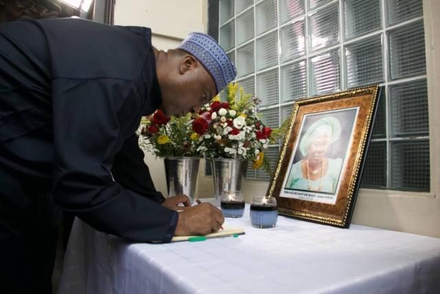 Senate President Bukola Saraki signing the Condolence Register for Ma Goldcoast Dickson