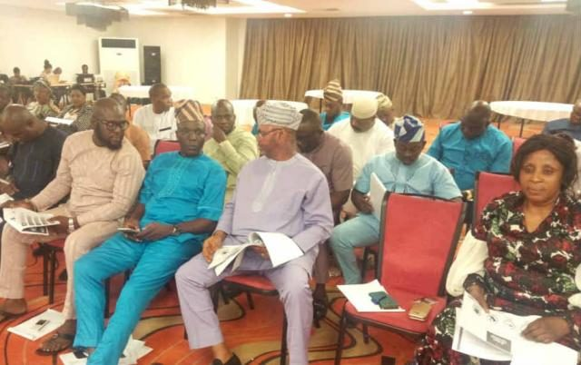 Omooba Sunday Solarin seated amongst other participants at the retreat