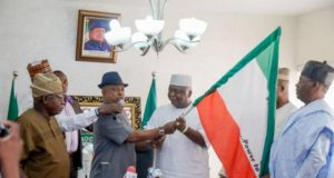 PDP National Chairman, Prince Uche Secondus handing over Ogun Governorship Flag to Hon Ladi Adebutu