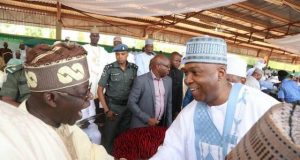Bola Tinubu in a dramatic Handshake with Bukola Saraki
