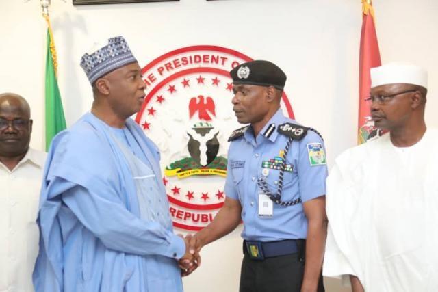 Senate President, Dr Abubakar Bukola Saraki with the Acting Inspector General of Police, Mohammed Adamu