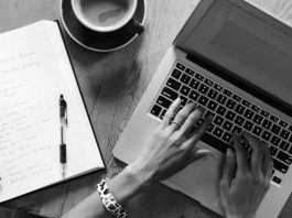 An Online News Editor or Content Writer with Laptop