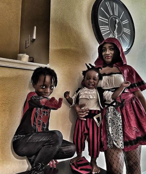 Olamide's partner, Adebukunmi and their kids