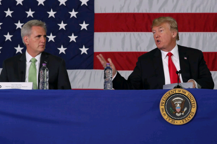U.S. President Donald Trump, flanked by House Majority Leader Kevin McCarthy