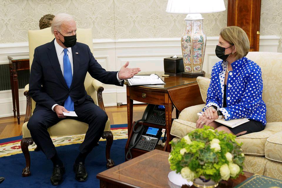 U.S. President Joe Biden gestures toward Senator Shelley Capito